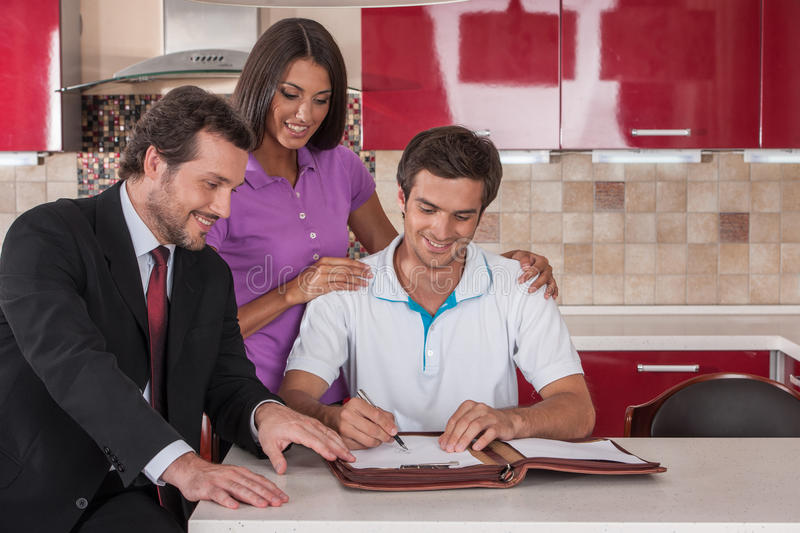 Happy man signing agreement on new house. royalty free stock photo