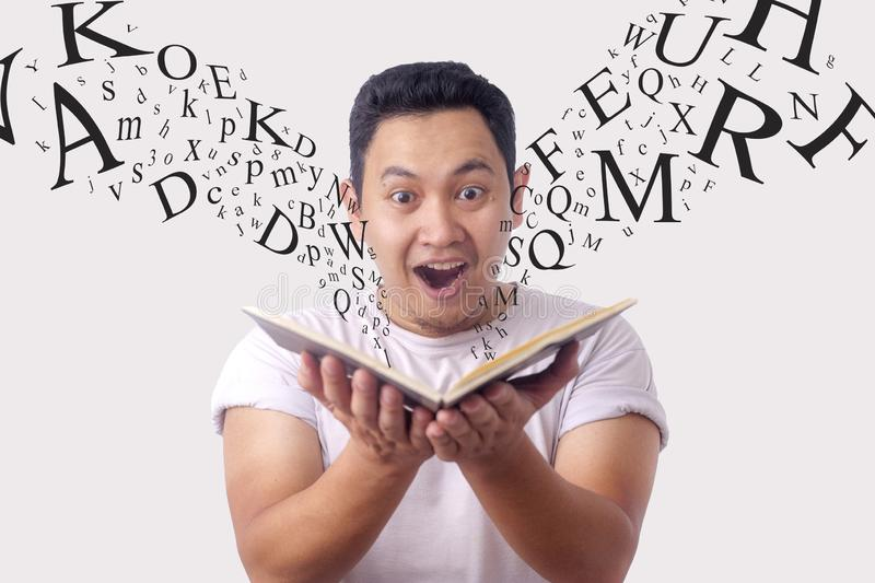 Happy Man Smiling While Reading Book stock photos