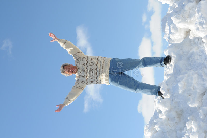 Happy man on a snow hill