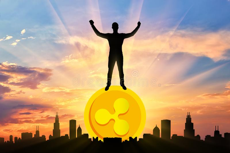 Happy man standing on a coin Ripple stock images
