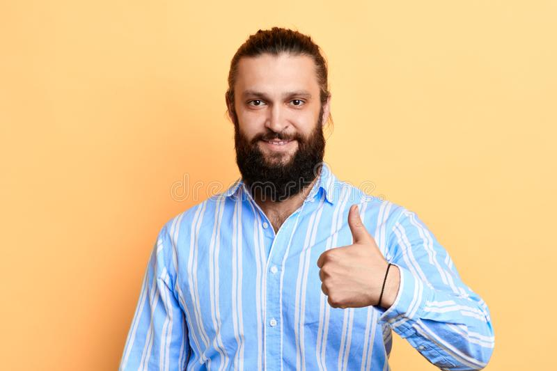 Happy man in stylish shirt showing thumb up royalty free stock images