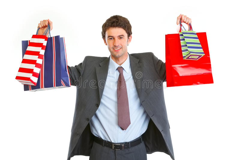 Happy man in suit with shopping bags in hands stock photos
