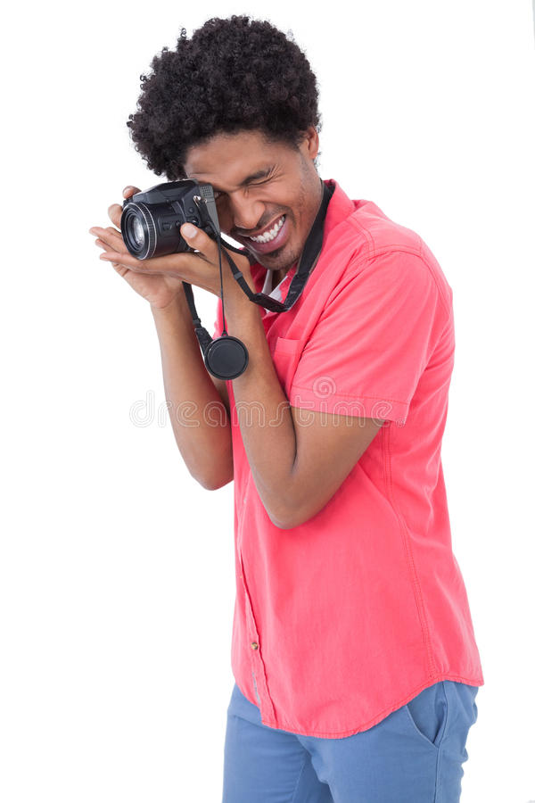 Happy man taking photograph with digital camera. On white background royalty free stock photography