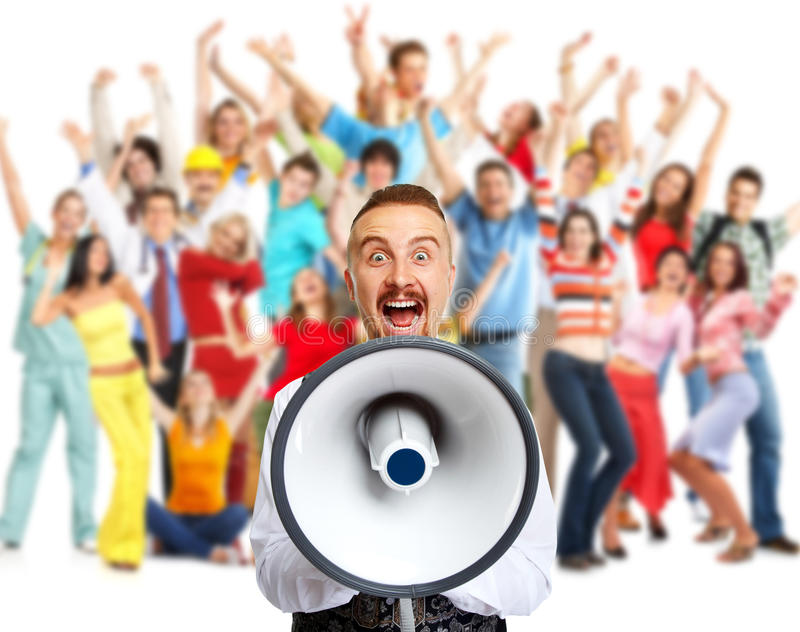 Happy man talking in loud-hailer. Young man talking in loud-hailer and group of happy people stock image