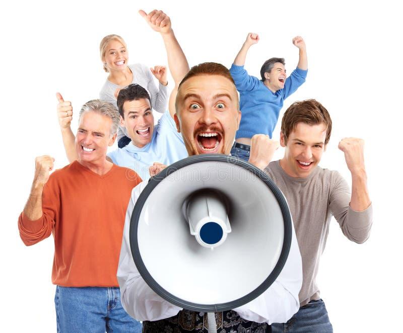 Happy man talking in loud-hailer. Young men talking in loud-hailer and group of happy people royalty free stock images