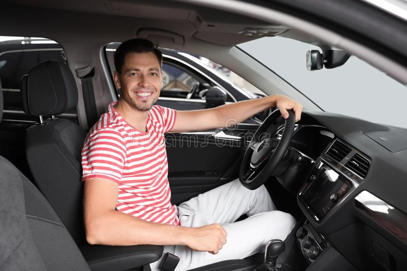 Happy man testing new car royalty free stock images