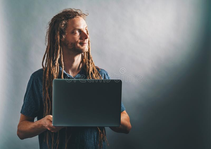 Happy man using a laptop royalty free stock images