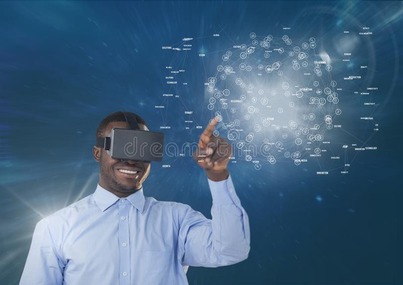 Happy man in VR headset touching interface with flares against blue background stock images
