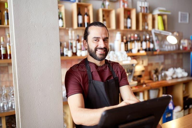 Happy man or waiter at bar cashbox royalty free stock image