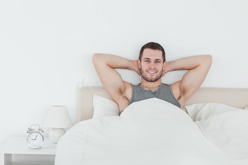 Download Happy man waking up stock image. Image of pillows, handsome - 22143235