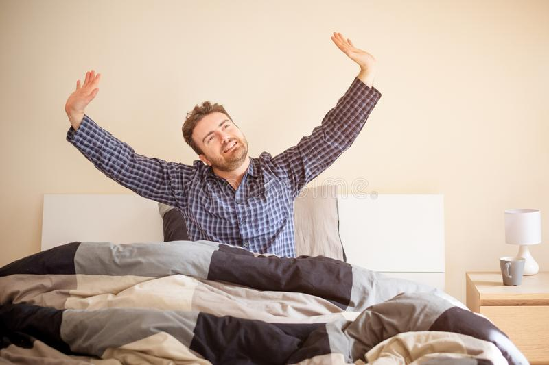 Comfortable man after good sleep in bed stock images