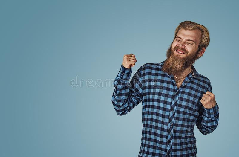 Happy man winning, fists pumped celebrating success stock photo