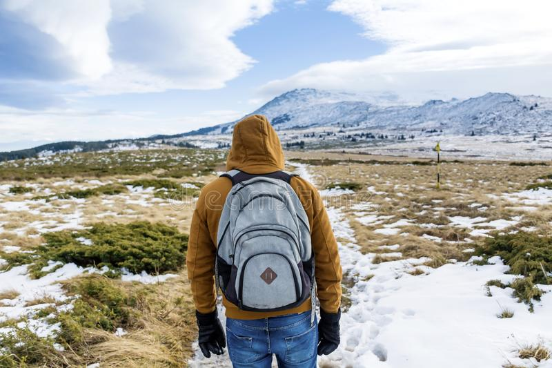 Tourist man in the winter mountain. Happy man in the winter Vitosha mountain,Bulgaria royalty free stock images