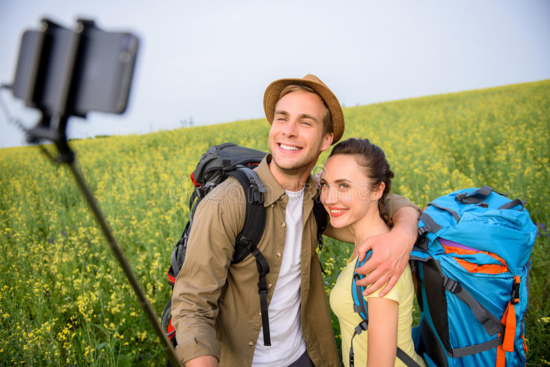 Happy man and woman making selfie in nature royalty free stock photos