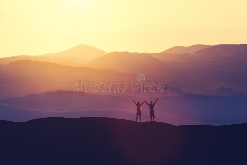 Happy man and woman standing on a hill royalty free illustration