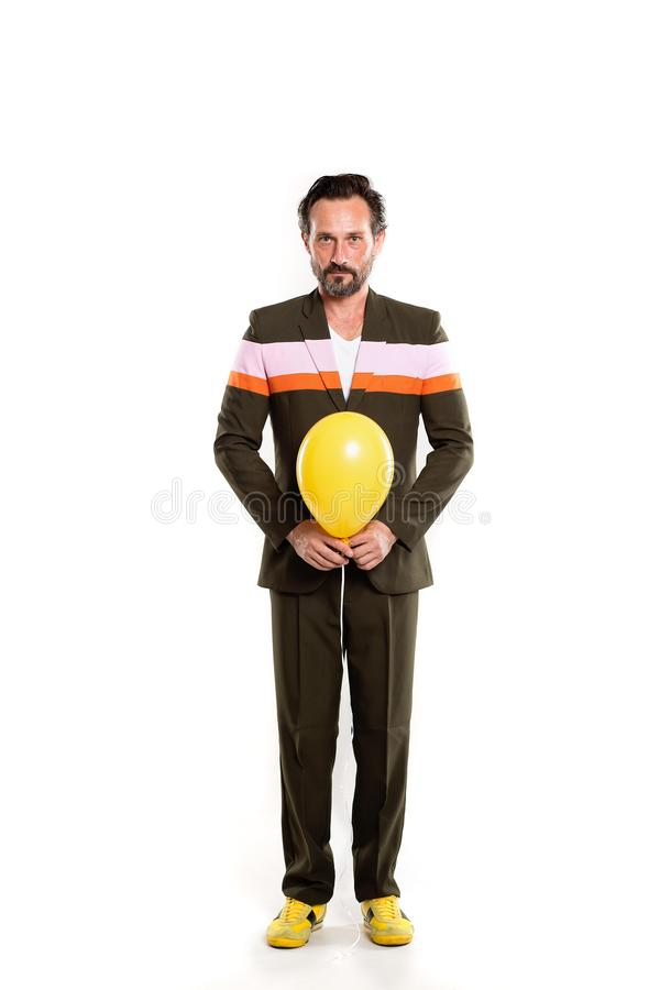 Happy man with yellow balloon. Happy man full length isolated on white background. Holding yellow balloon stock photography