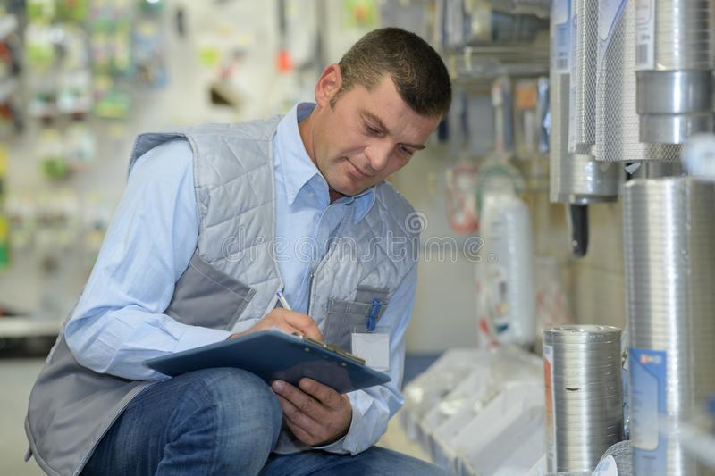 Happy manager with clipboard at factory stock photos