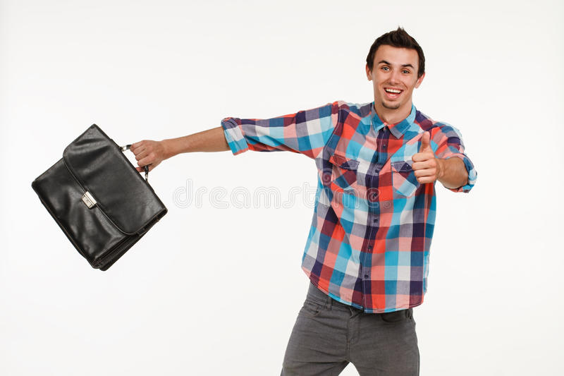 Happy manager concluded a bargain. Smash employee with thumbs-up. Young successfull office worker royalty free stock image