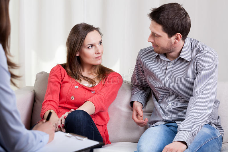 Happy marriage at the and of therapy session stock photo