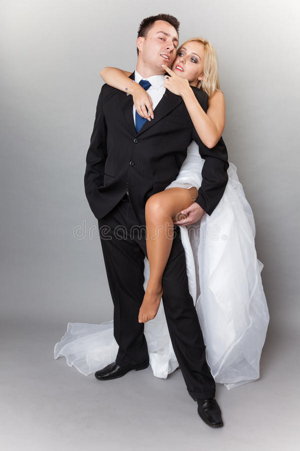 Happy married couple bride groom on gray background stock images