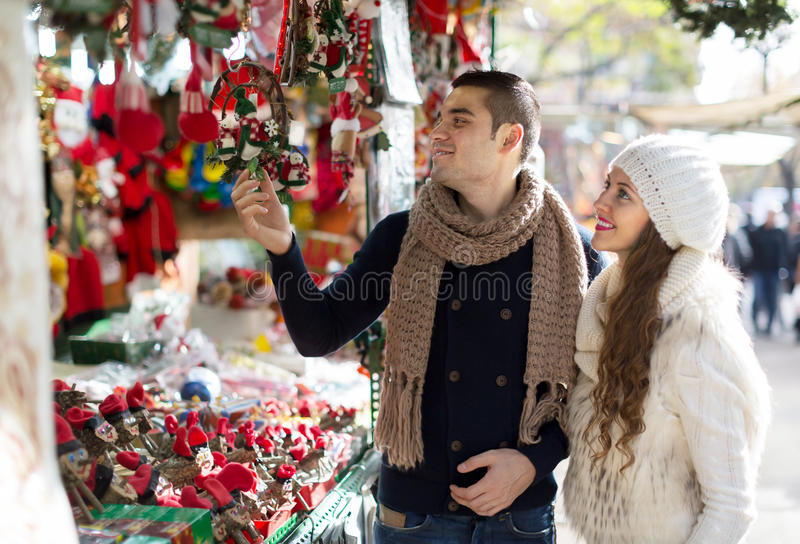 Happy married couple at Catalan Christmas market royalty free stock photos