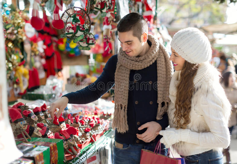 Happy married couple at Catalan Christmas market royalty free stock photography
