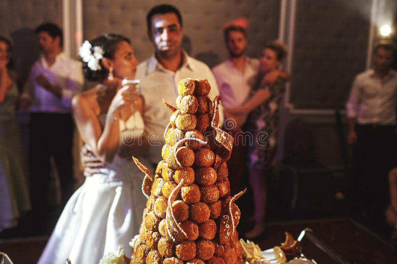 Happy married couple eating delicious chocolate wedding cake at stock images