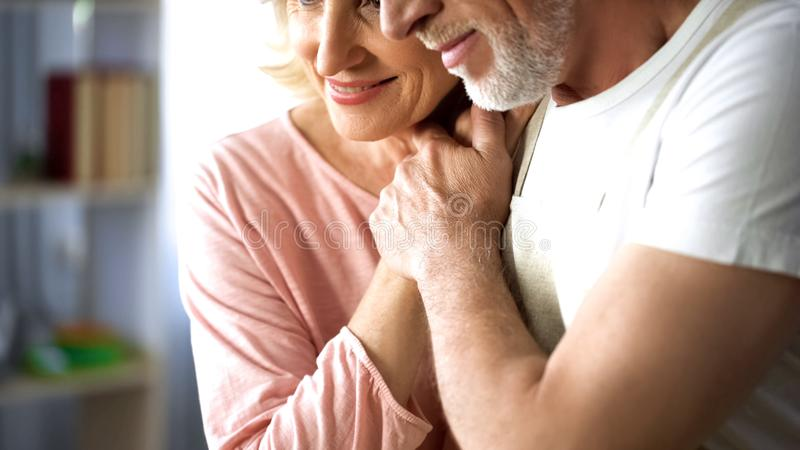 Happy married couple holding hands, old age togetherness, love and understanding. Stock photo stock photos