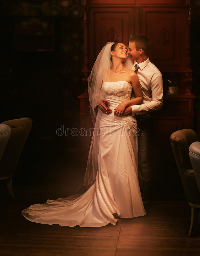 Happy married couple in old interior royalty free stock photos