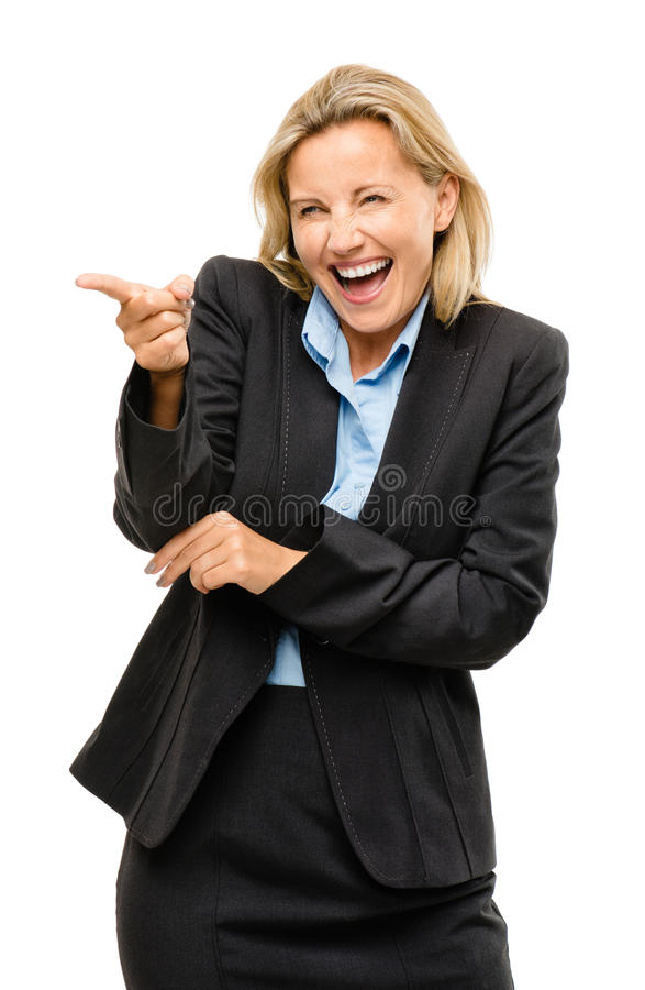 Happy mature business woman pointing laughing being silly isolated on white background. Happy mature business woman pointing laughing being silly stock photos