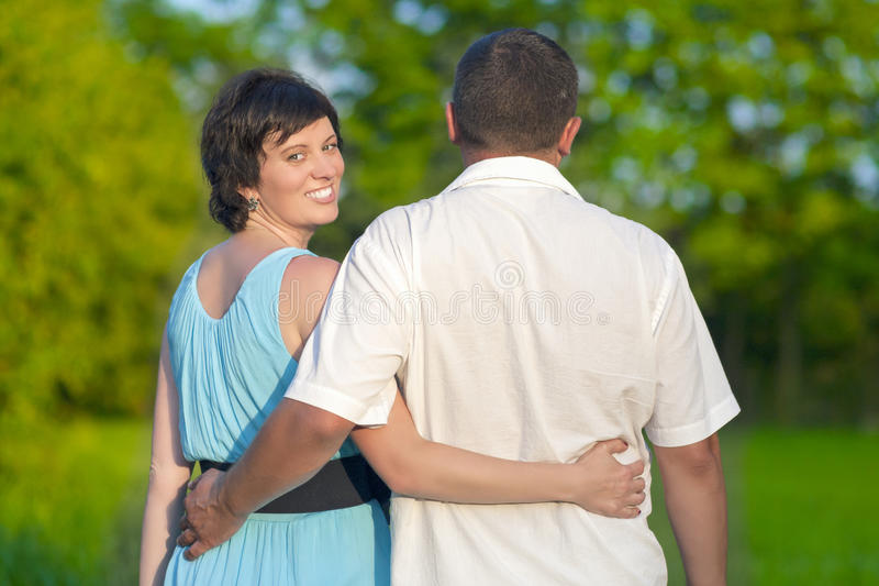 Happy Mature Caucasian Couple Having a Walk Together Outdoors. Embraced Together royalty free stock photo