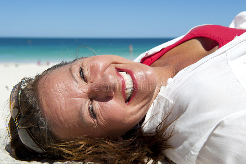 Happy Mature and Confident Woman at Ocean stock image