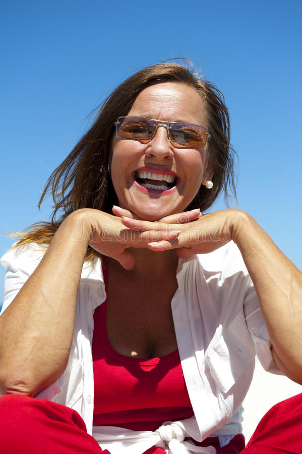 Happy Mature and Confident Woman at Ocean stock photo