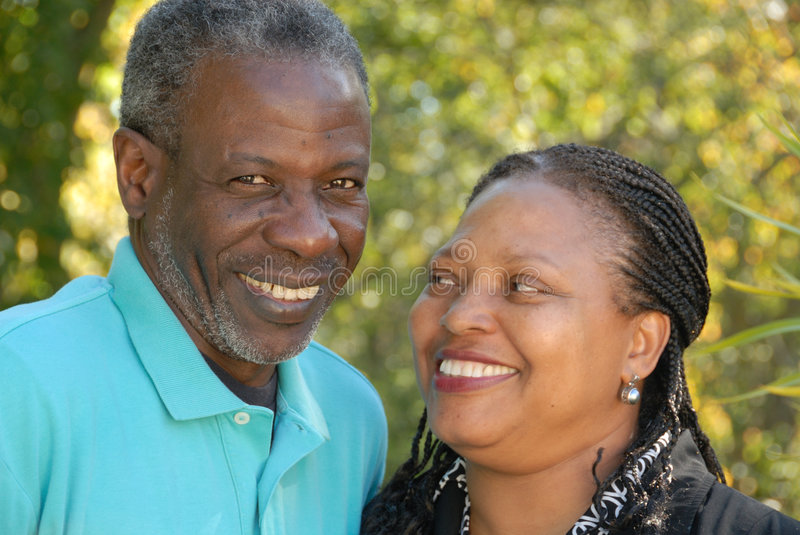 Happy mature couple. Ethnically diverse mature couple, smiling and in love