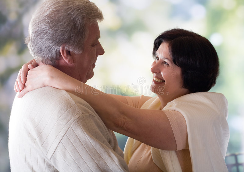 Happy mature couple embracing or dancing royalty free stock photo