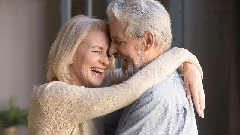 Happy mature couple embracing, laughing husband and wife, banner stock image