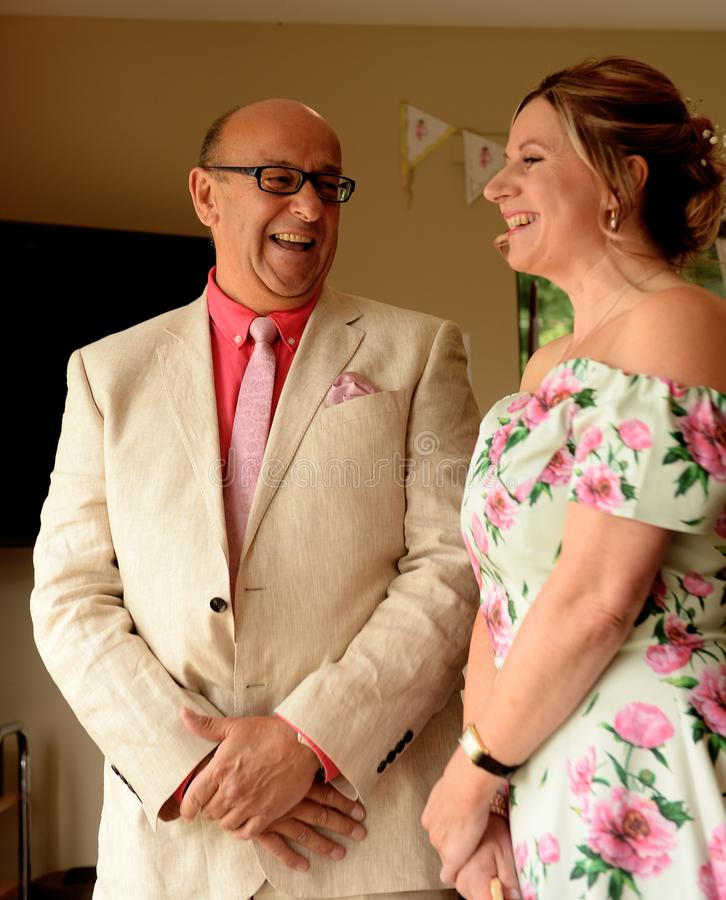 Mature couple at wedding ceremony stock photography