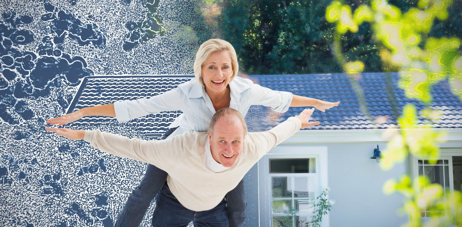 Composite image of happy mature couple having fun royalty free stock images