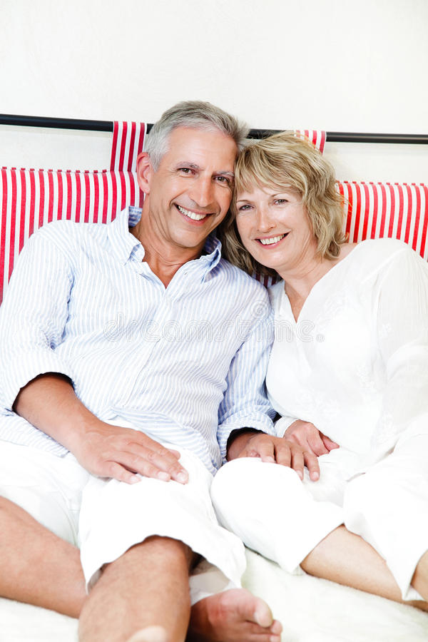 Happy mature couple at home stock images