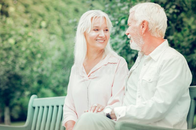 Happy mature couple looking at each other stock photos