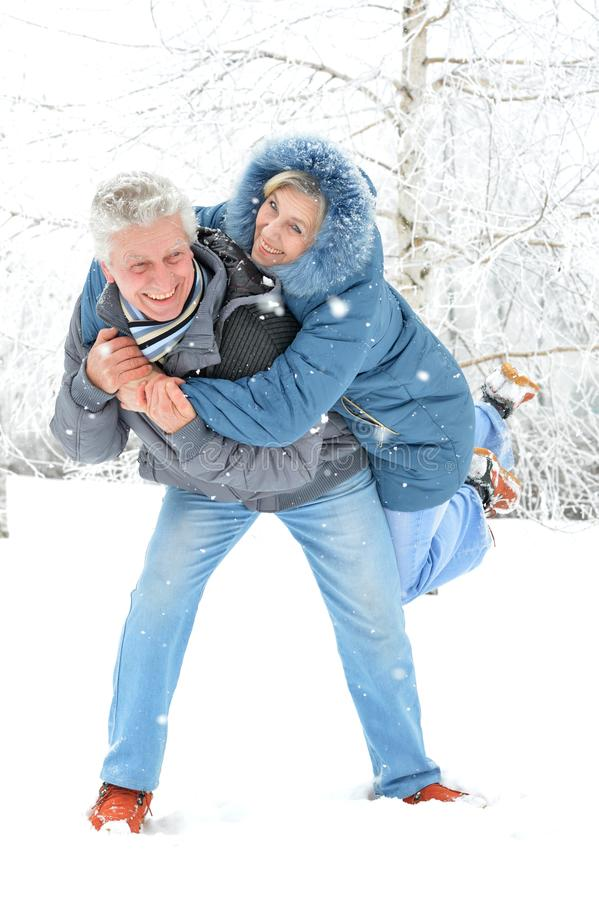 Man giving piggyback ride to woman royalty free stock photography