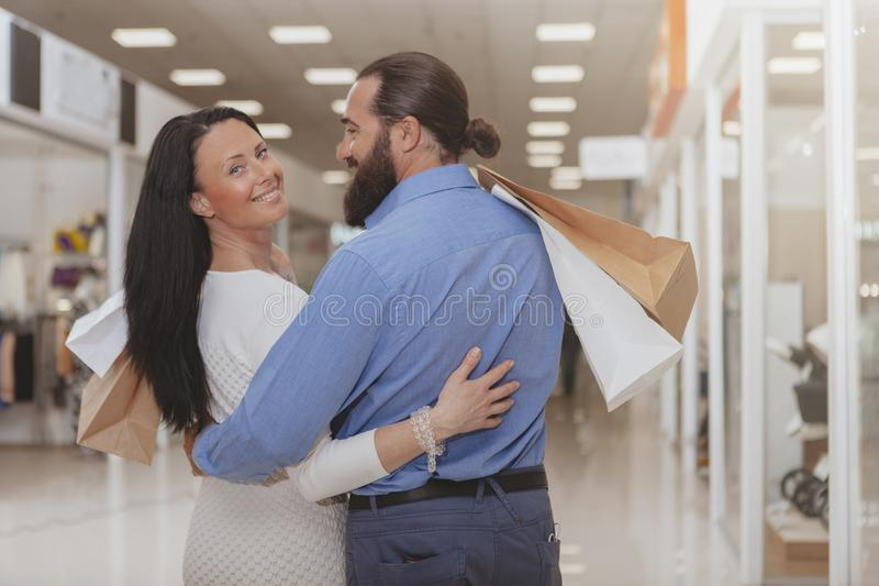 Happy mature couple shopping at the mall stock photo