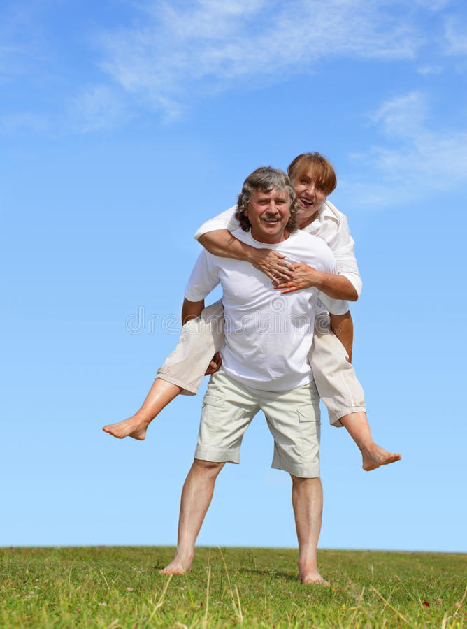 Download Happy mature pair stock image. Image of mature, grass - 13287211