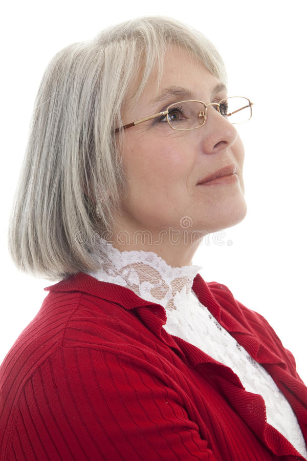 Happy mature woman. Mature, attractive Caucasian woman looking off into the distance royalty free stock photography
