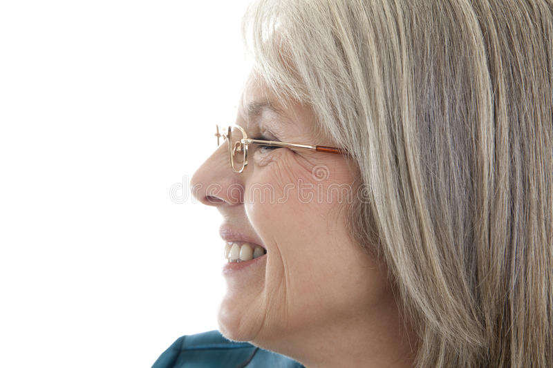 Happy mature woman. Mature, attractive Caucasian woman looking off into the distance stock photography