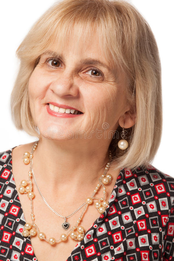 Happy mature woman. Portrait of happy mature or senior woman with blond hair, white background royalty free stock photos