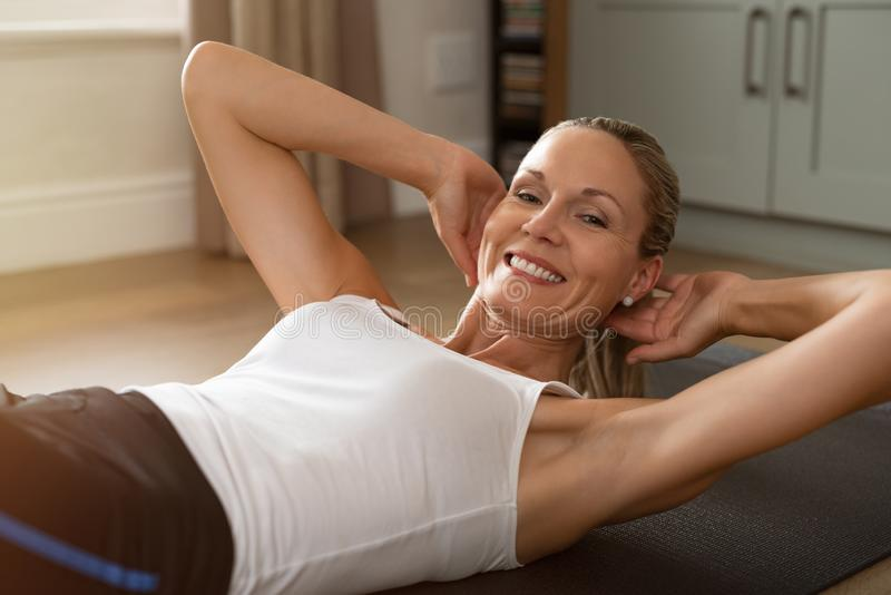 Happy mature woman exercising royalty free stock photo