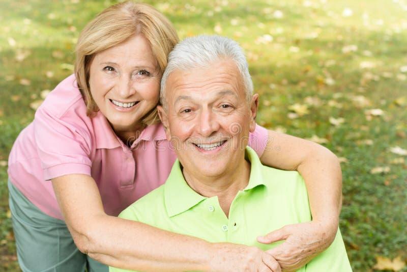 happy mature woman hugging her husband stock photos