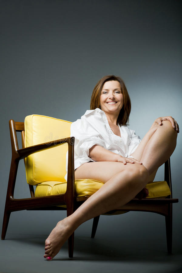 Download Happy Mature Woman Relaxing On Chair. Stock Image - Image: 22109667