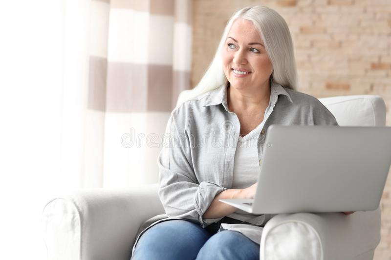 Mature Female Doctor Working In Doctors Office Stock Image
